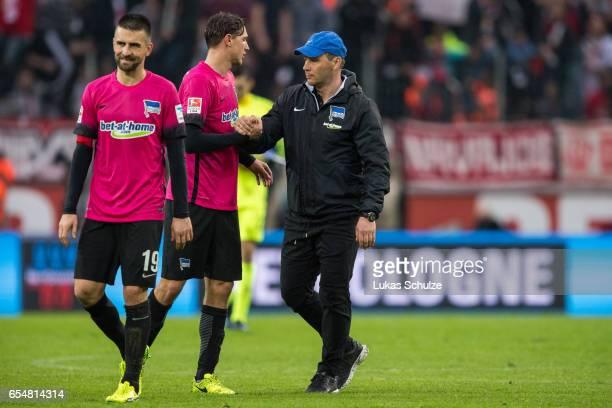 Head Coach Pal Dardai of Berlin shake hands with his teammates after loosing the Bundesliga match between 1 FC Koeln and Hertha BSC at...