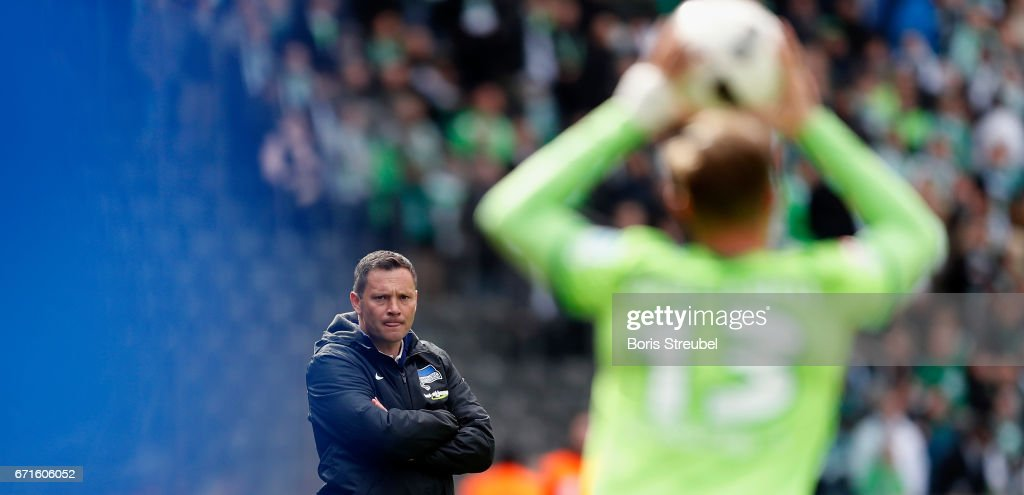 Head coach Pal Dardai of Hertha BSC watches Yannick Gerhardt of VfL Wolfsburg to take a throw-in during the Bundesliga match between Hertha BSC and VfL Wolfsburg at Olympiastadion on April 22, 2017 in Berlin, Germany.