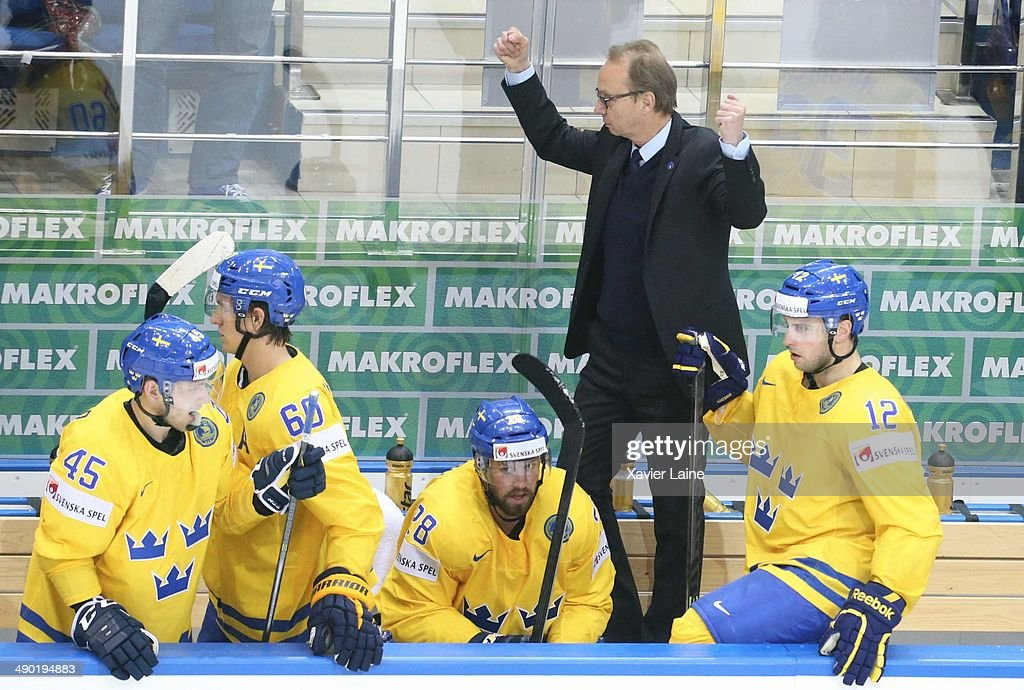 Head coach Par Marts (R) of Sweden celebrate the victory after the 2014 IIHF World Championship between Sweden and Norway at Chizhovka arena on May 13, 2014 in Minsk, Belarus.