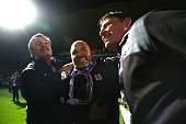 Head Coach Pascal Dupraz of Toulouse celebrates with his staff members after the football french Ligue 1 match between Angers SCO and Toulouse FC on...