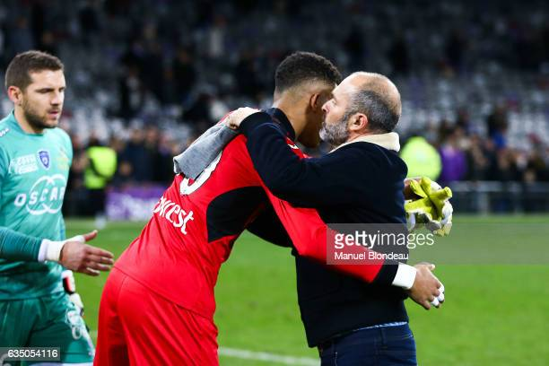 Head coach Pascal Dupraz of Toulouse hugs Alban Lafont at the end of the match during the Ligue 1 match between Toulouse Fc and Sc Bastia at Stadium...