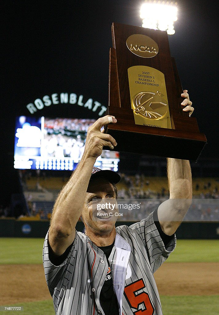 Head coach Pat Casey of the Oregon State Beavers holds up the championship trophy after defeating the North Carolina Tar Heels 93 in Game 2 to claim...