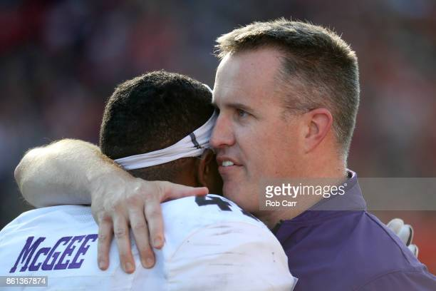 Head coach Pat Fitzgerald of the Northwestern Wildcats hugs Jared McGee against the Maryland Terrapins in the first half at Capital One Field on...
