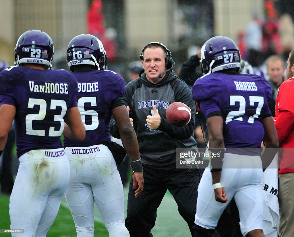 Head coach <a gi-track='captionPersonalityLinkClicked' href=/galleries/search?phrase=Pat+Fitzgerald&family=editorial&specificpeople=877167 ng-click='$event.stopPropagation()'>Pat Fitzgerald</a> of the Northwestern Wildcats reacts to a play against the Wisconsin Badgers during the first half on October 4, 2014 at Ryan Field in Evanston, Illinois.