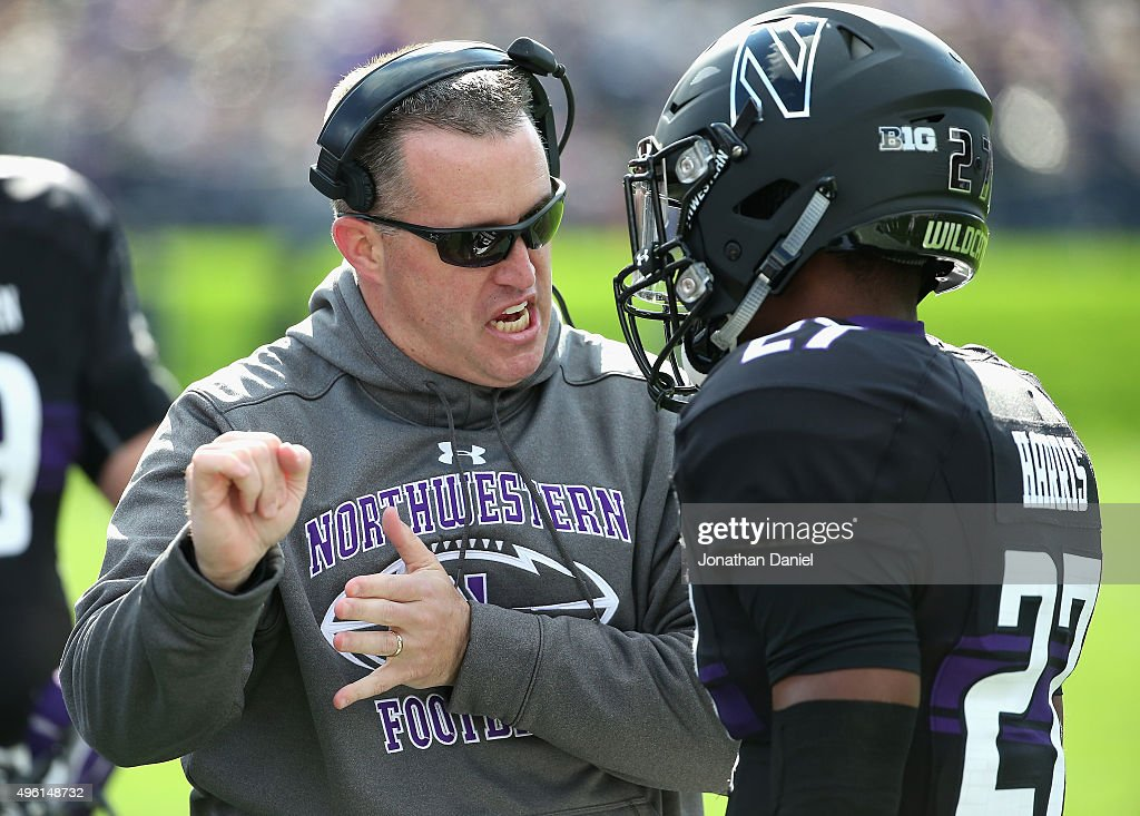 Head coach <a gi-track='captionPersonalityLinkClicked' href=/galleries/search?phrase=Pat+Fitzgerald&family=editorial&specificpeople=877167 ng-click='$event.stopPropagation()'>Pat Fitzgerald</a> of the Northwestern Wildcats talks with Matthew Harris #27 on the sidelines during a game against the Penn State Nittany Lions at Ryan Field on November 7, 2015 in Evanston, Illinois.