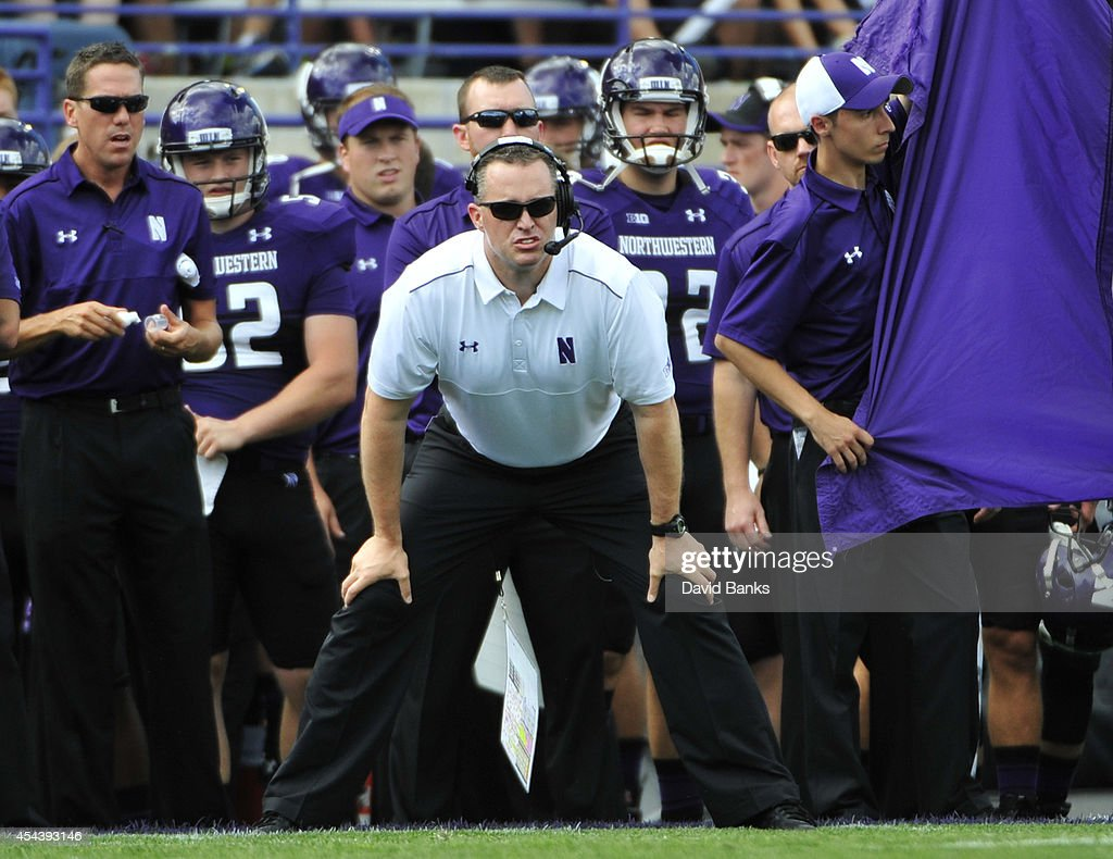 Head coach <a gi-track='captionPersonalityLinkClicked' href=/galleries/search?phrase=Pat+Fitzgerald&family=editorial&specificpeople=877167 ng-click='$event.stopPropagation()'>Pat Fitzgerald</a> of the Northwestern Wildcats watches a play against the California Golden Bears during the first half on August 30, 2014 at Ryan Field in Evanston, Illinois.