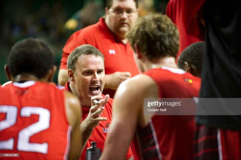 Head coach Pat Knight of the Lamar Cardinals has words with his team during a timeout against the Baylor University Bears on December 12, 2012 at the Ferrell Center in Waco, Texas.