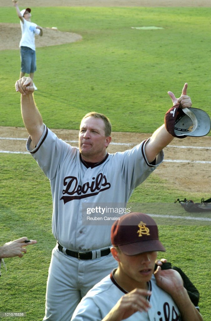 Head coach Pat Murphy of the Arizona State Sun Devils celebrates a trip to the College World Series after 9 to 8 victory in the NCAA Fullerton...
