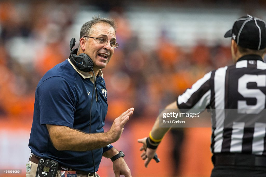 Head coach Pat Narduzzi of the Pittsburgh Panthers speaks with a referee during the second half against the Syracuse Orange on October 24 2015 at The...