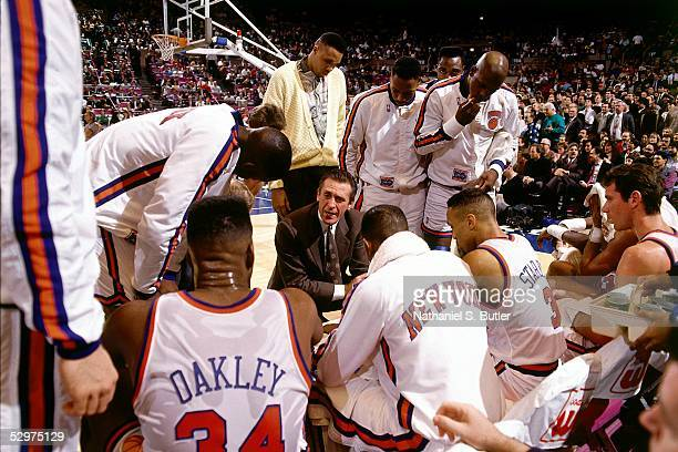 Head Coach Pat Riley of the New York Knicks talks with the Knicks players during a time out at Madison Square Garden circa 1991 in New York New York...