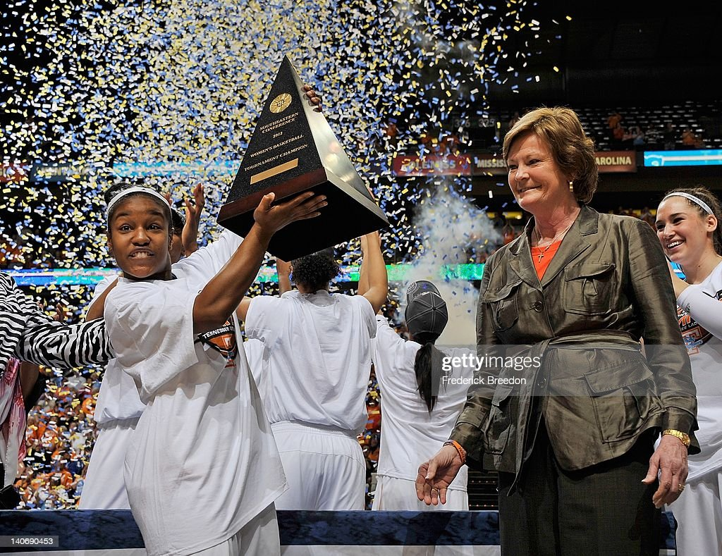 Head coach <a gi-track='captionPersonalityLinkClicked' href=/galleries/search?phrase=Pat+Summitt&family=editorial&specificpeople=718767 ng-click='$event.stopPropagation()'>Pat Summitt</a> of the Tennessee Volunteers and Briana Bass celebrate with the championship trophy after defeating the LSU Tigers in the SEC Women's Basketball Tournament Championship game at the Bridgestone Arena on March 4, 2012 in Nashville, Tennessee.