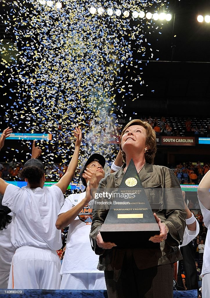 Head coach <a gi-track='captionPersonalityLinkClicked' href=/galleries/search?phrase=Pat+Summitt&family=editorial&specificpeople=718767 ng-click='$event.stopPropagation()'>Pat Summitt</a> of the Tennessee Volunteers holds the championship trophy after winning the SEC Women's Basketball Tournament Championship game at the Bridgestone Arena on March 4, 2012 in Nashville, Tennessee.