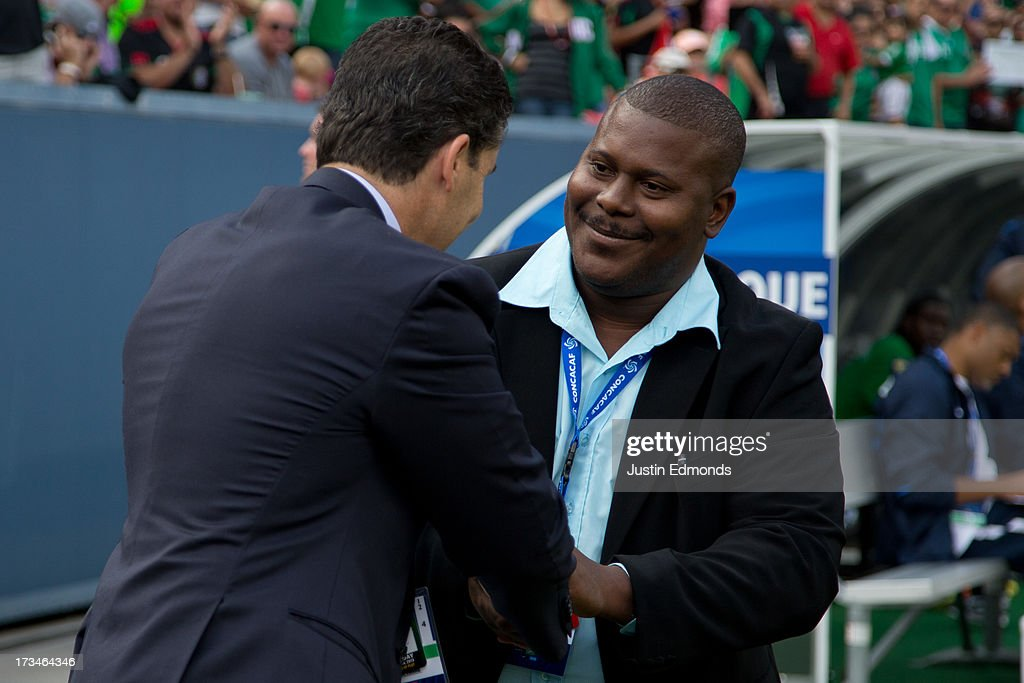 Head Coach Patrick Cavelan of Martinique greets Head Coach Jose Manuel de la Torre of Mexico before their CONCACAF Gold Cup match at Sports Authority Field at Mile High on July 14, 2013 in Denver, Colorado.