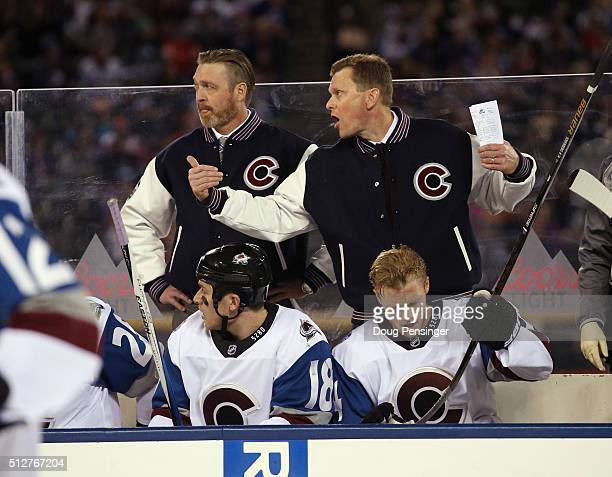 Head coach Patrick Roy and assistant coach Tim Army of the Colorado Avalanche handle bench duties against the Detroit Red Wings at Coors Field during...
