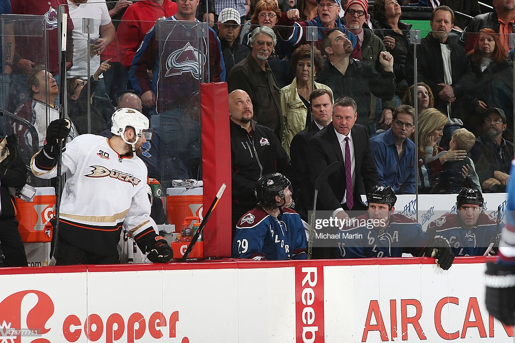 Head coach Patrick Roy and Cody McLeod #55 of the Colorado Avalanche look over to Patrick Maroon #62 of the Anaheim Ducks at the Pepsi Center on March 14, 2014 in Denver, Colorado.