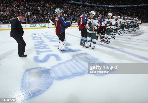 Head coach Patrick Roy of the Colorado Avalanche and goalie Semyon Varlamov of the Colorado Avalanche line up to congratulate Zach Parise and the...