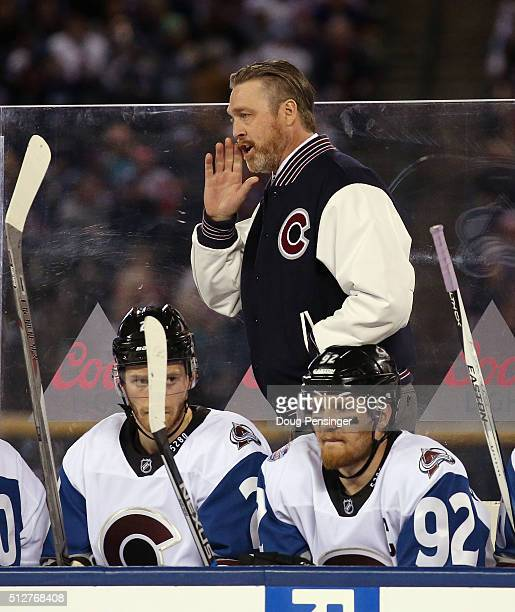 Head coach Patrick Roy of the Colorado Avalanche handles bench duties against the Detroit Red Wings at Coors Field during the 2016 Coors Light...