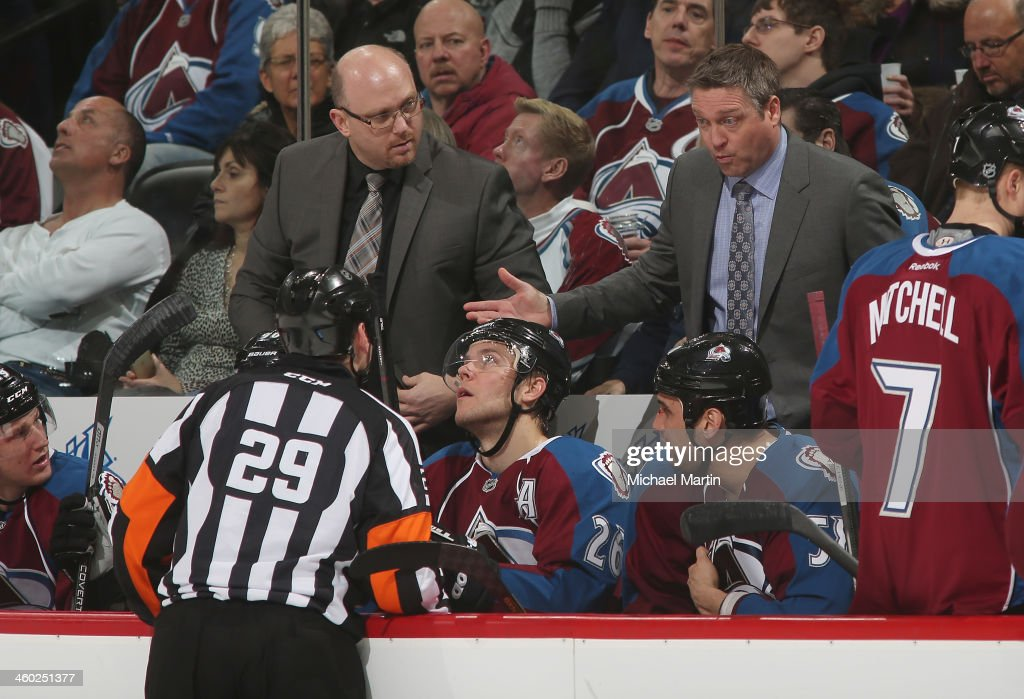 Head coach <a gi-track='captionPersonalityLinkClicked' href=/galleries/search?phrase=Patrick+Roy&family=editorial&specificpeople=204512 ng-click='$event.stopPropagation()'>Patrick Roy</a> of the Colorado Avalanche talks with an official during a timeout in the game against the Philadelphia Flyers at the Pepsi Center on January, 2014 in Denver, Colorado.