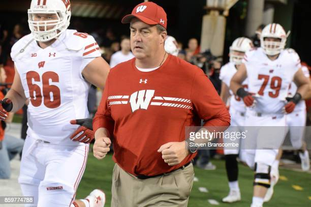 Head coach Paul Chryst of the Wisconsin Badgers runs on the field before the game against the Nebraska Cornhuskers at Memorial Stadium on October 7...