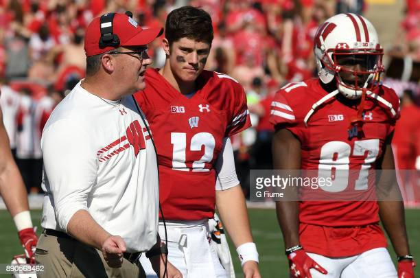 Head Coach Paul Chryst of the Wisconsin Badgers talks to his players during a break in the game against the Maryland Terrapins at Camp Randall...