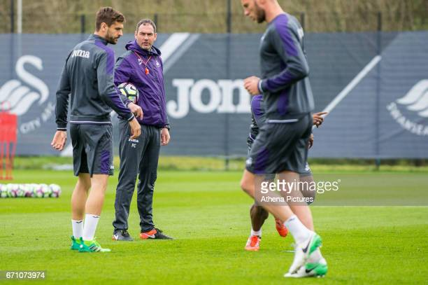 Head coach Paul Clement speaks to Fernando Llorente during the Swansea City Training at The Fairwood Training Ground on April 20 2017 in Swansea Wales