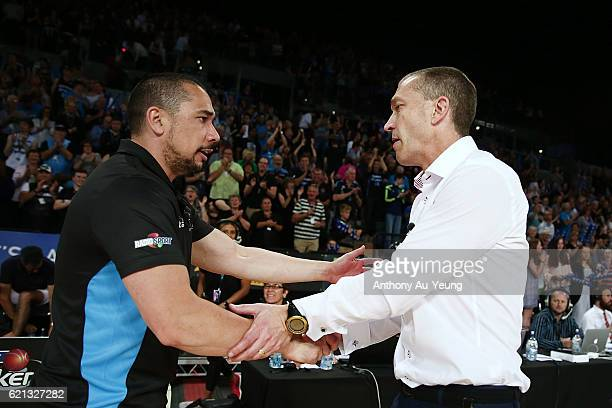Head Coach Paul Henare of New Zealand shakes hand with Head Coach Andrej Lemanis of Brisbane after the round five NBL match between the New Zealand...