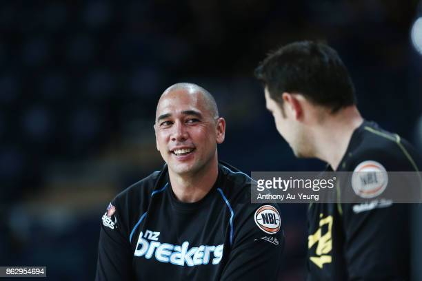 Head Coach Paul Henare of the Breakers chats to Assistant Coach Luke Kendall of the Kings prior to the round three NBL match between the New Zealand...