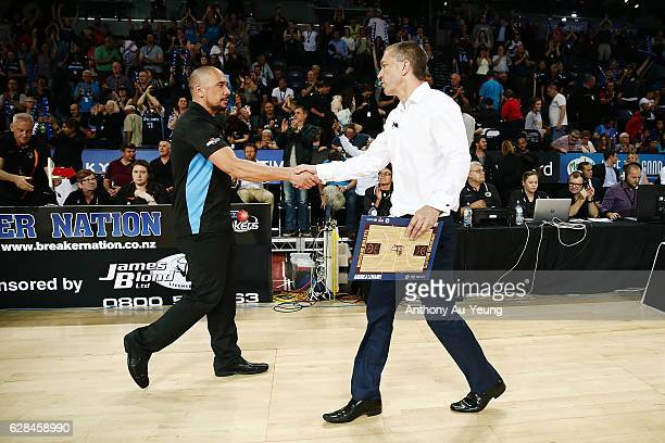 Head Coach Paul Henare of the Breakers shakes hand with Head Coach Andrej Lemanis of the Bullets after the round 10 NBL match between the New Zealand...