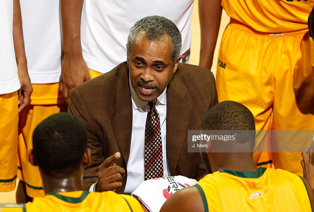 Head coach <a gi-track='captionPersonalityLinkClicked' href=/galleries/search?phrase=Paul+Hewitt&family=editorial&specificpeople=213960 ng-click='$event.stopPropagation()'>Paul Hewitt</a> of the George Mason Patriots directs his team against the South Florida Bulls during the game at the Sun Dome on December 29, 2012 in Tampa, Florida.