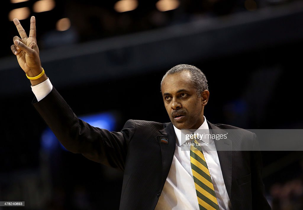 Head coach <a gi-track='captionPersonalityLinkClicked' href=/galleries/search?phrase=Paul+Hewitt&family=editorial&specificpeople=213960 ng-click='$event.stopPropagation()'>Paul Hewitt</a> of the George Mason Patriots gestures from the bench in the first half against the Fordham Rams during the first round of the Atlantic 10 Men's Basketball Tournament at Barclays Center on March 12, 2014 in the Brooklyn Borough of New York City.