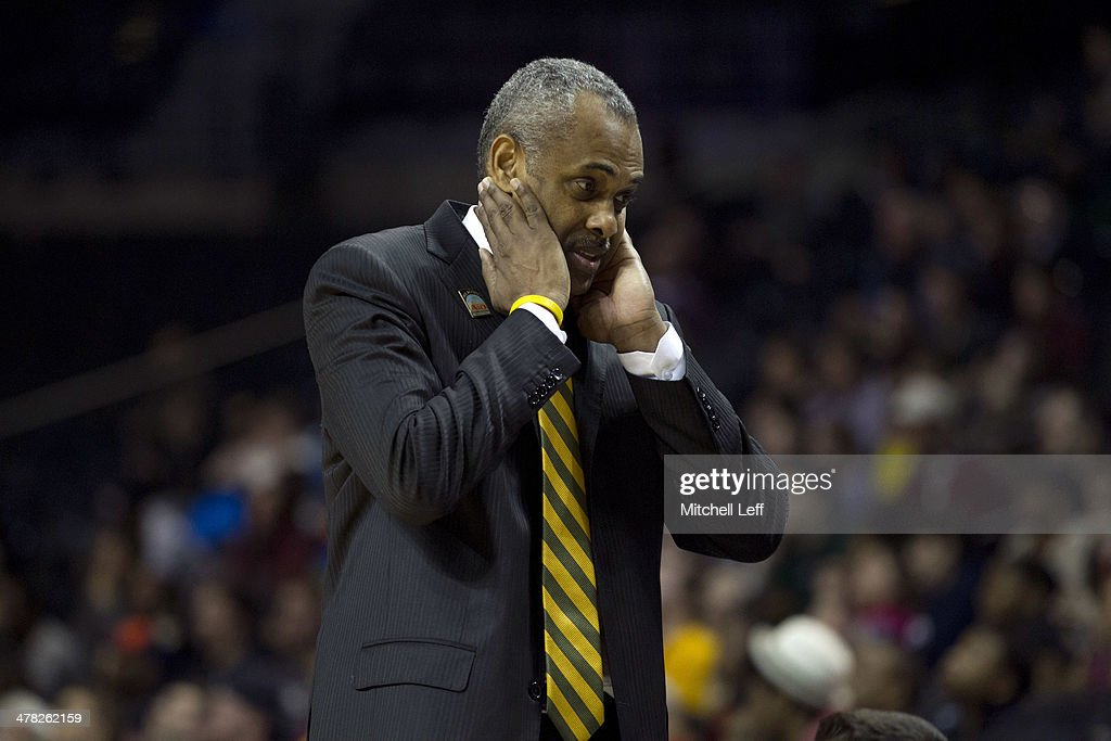 Head coach <a gi-track='captionPersonalityLinkClicked' href=/galleries/search?phrase=Paul+Hewitt&family=editorial&specificpeople=213960 ng-click='$event.stopPropagation()'>Paul Hewitt</a> of the George Mason Patriots reacts during the game against the Fordham Rams in the first round of the men's Atlantic 10 tournament on March 12, 2014 at the Barclays Center in the Brooklyn borough of New York City.