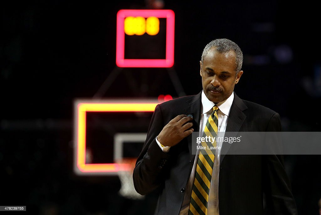 Head coach <a gi-track='captionPersonalityLinkClicked' href=/galleries/search?phrase=Paul+Hewitt&family=editorial&specificpeople=213960 ng-click='$event.stopPropagation()'>Paul Hewitt</a> of the George Mason Patriots walks off the court after being defeated by the Fordham Rams during the first round of the Atlantic 10 Men's Basketball Tournament at Barclays Center on March 12, 2014 in the Brooklyn Borough of New York City.