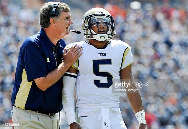 Head coach Paul Johnson gives instruction to quarterback Justin Thomas of the Georgia Tech Yellow Jackets in the first half against Virginia Tech at...