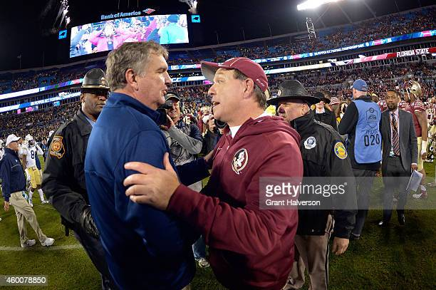 Head coach Paul Johnson of the Georgia Tech Yellow Jackets and head coach Jimbo Fisher of the Florida State Seminoles shake hands after the Atlantic...