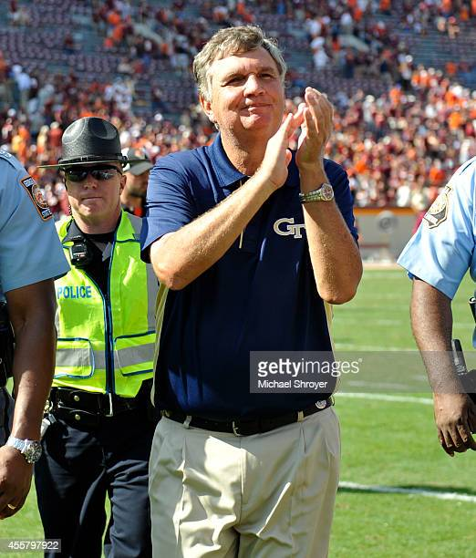 Head coach Paul Johnson of the Georgia Tech Yellow Jackets exits the field following the game against Virginia Tech at Lane Stadium on September 20...