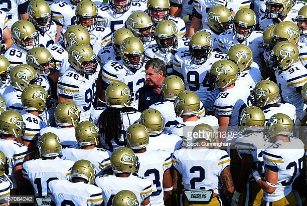 Head Coach Paul Johnson of the Georgia Tech Yellow Jackets huddles with his team before the start of the second half against the Duke Blue Devils at...