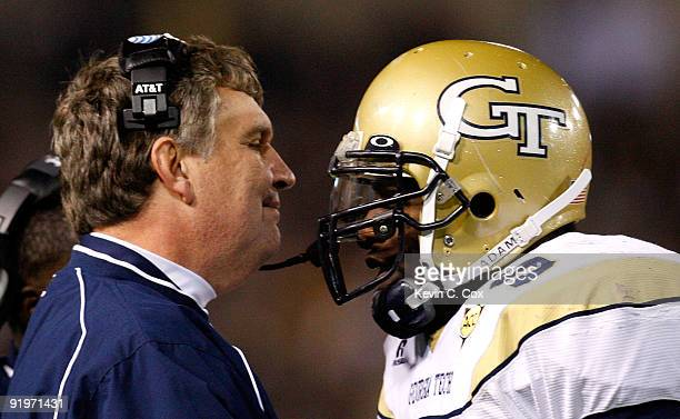 Head coach Paul Johnson of the Georgia Tech Yellow Jackets congratulates quarterback Josh Nesbitt after his touchdown against the Virginia Tech...