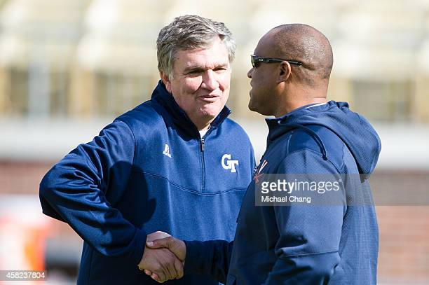 Head coach Paul Johnson of the Georgia Tech Yellow Jackets shake hands with head coach Mike London of the Virginia Cavaliers prior to their game on...