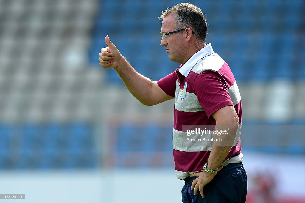 Head coach Paul Lambert reacts during the pre-season friendly match between VfL Bochum and Aston Villa at Rewirpower Stadium on July 14, 2013 in Bochum, Germany.