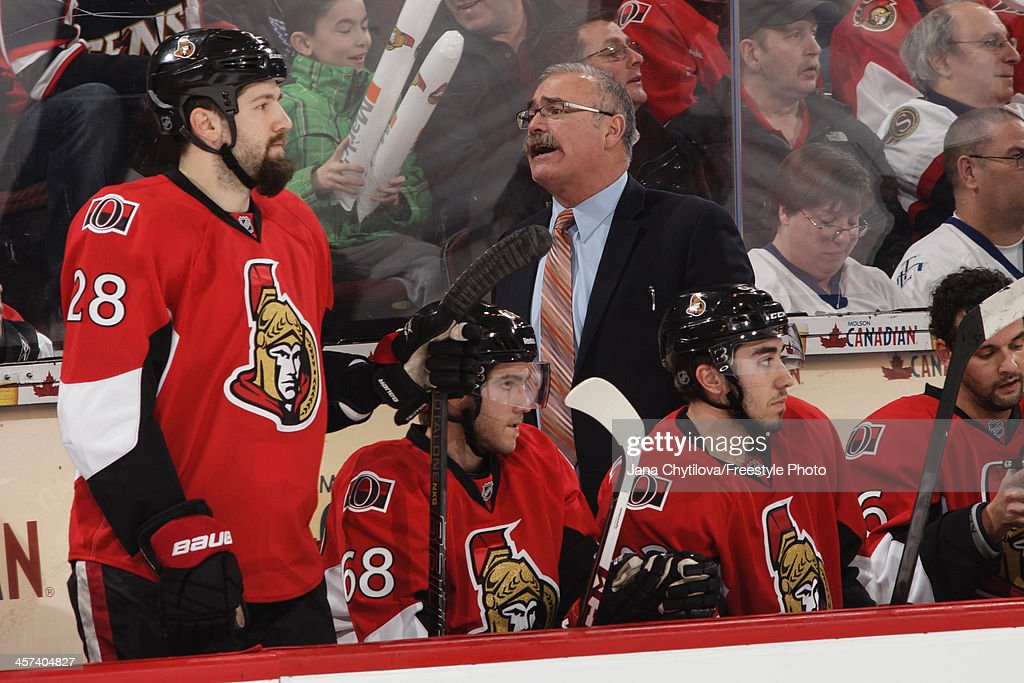 Head coach Paul MacLean of the Ottawa Senators looks on from the bench during an NHL game against the Toronto Maple Leafs at Canadian Tire Centre on...