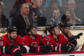 Head coach Paul MacLean of the Ottawa Senators looks on from the bench without his glasses on during an NHL game against the Philadelphia Flyers at...