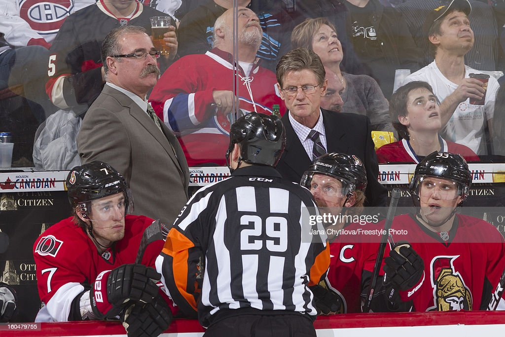 Head coach Paul MacLean of the Ottawa Senators schats with referee Ian Walsh #29 during an NHL game against the Montreal Canadiens at Scotiabank Place on January 30, 2013 in Ottawa, Ontario, Canada.