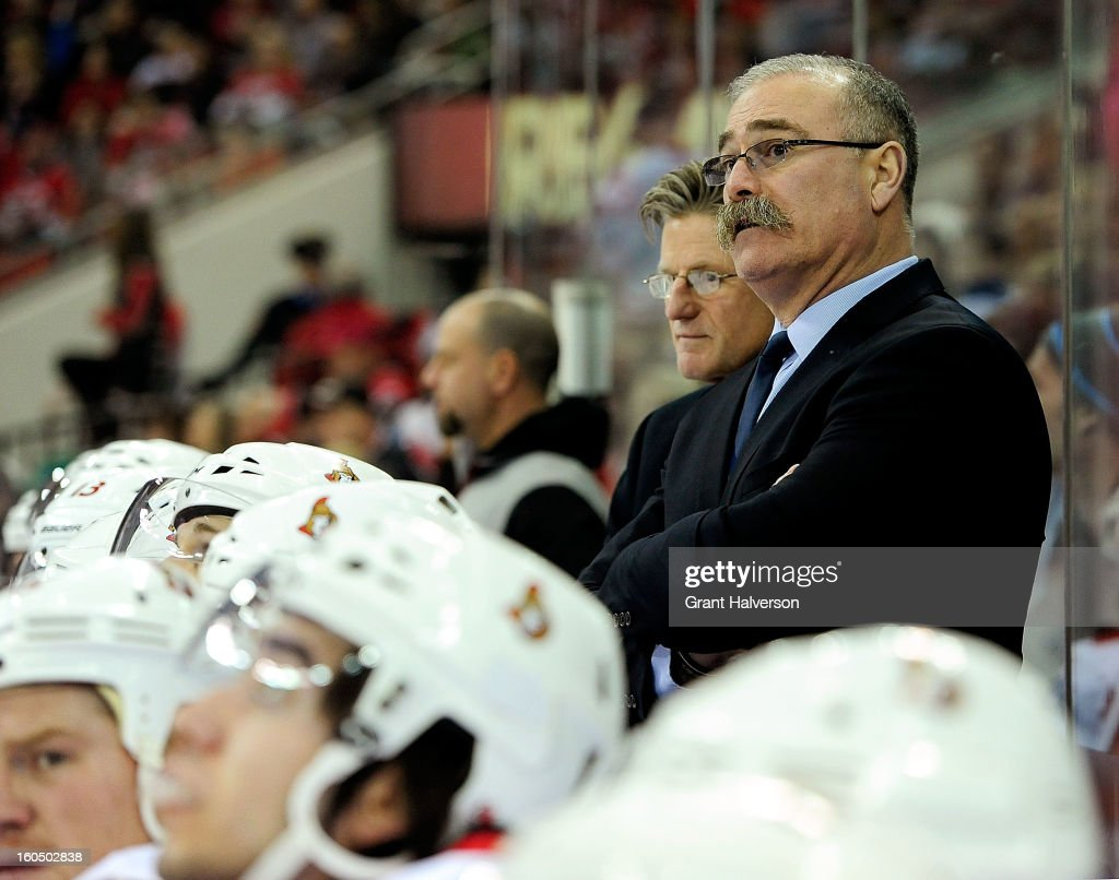Head coach Paul MacLean of the Ottowa Senators watches his team during a loss to the Carolina Hurricanes at PNC Arena on February 1, 2013 in Raleigh, North Carolina. The Hurricanes won 1-0.