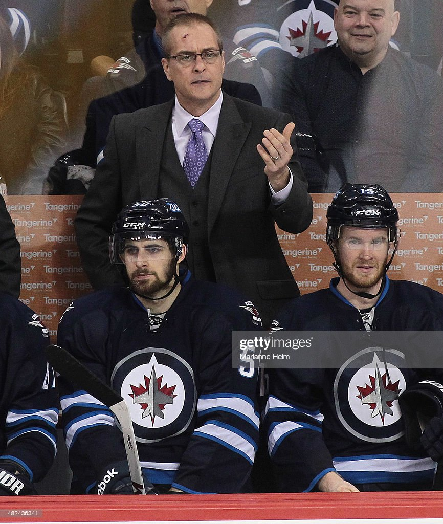 Head coach Paul Maurice of the Winnipeg Jets gestures from the bench in third-period action against the Pittsburgh Penguins at the MTS Centre on April 3, 2014 in Winnipeg, Manitoba, Canada.