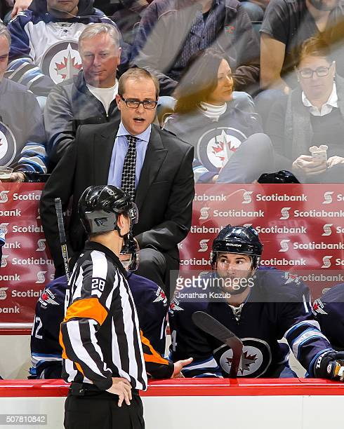 Head Coach Paul Maurice of the Winnipeg Jets has words with referee Chris Lee during a third period stoppage in play against the Arizona Coyotes at...