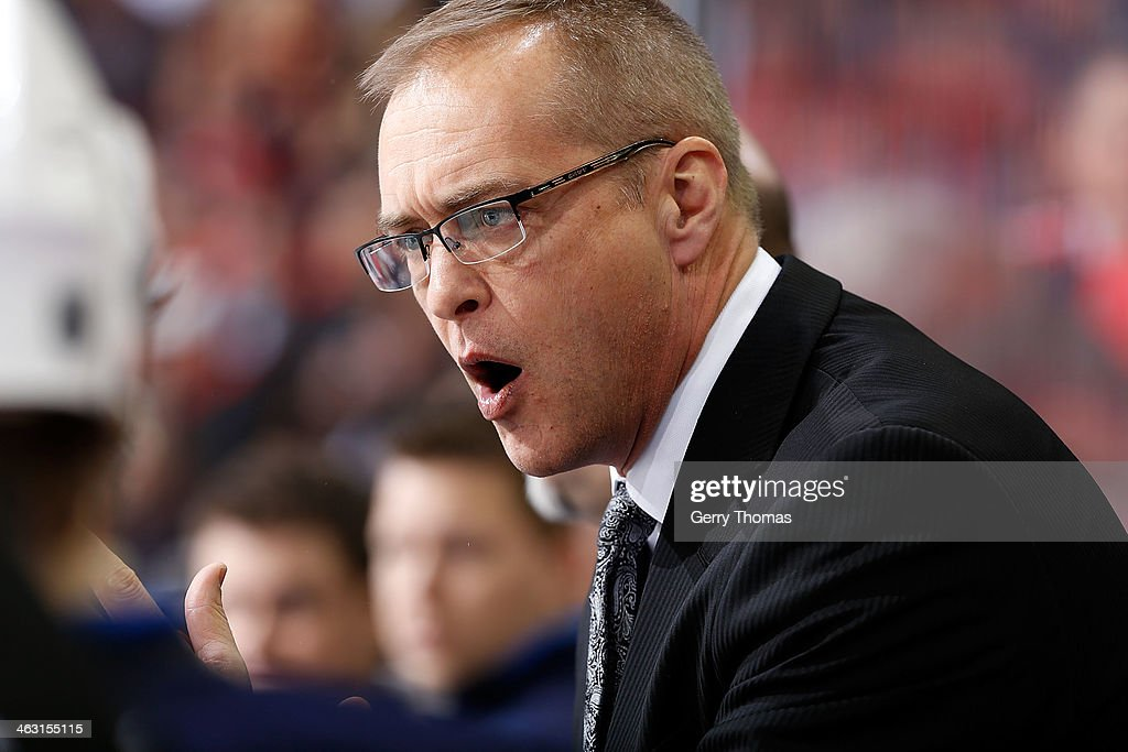 Head Coach Paul Maurice of the Winnipeg Jets instructs his players during the game against the Calgary Flames at Scotiabank Saddledome on January 16, 2013 in Calgary, Alberta, Canada.