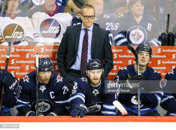 Head Coach Paul Maurice of the Winnipeg Jets looks on from the bench during third period action against the Carolina Hurricanes at the Bell MTS Place...