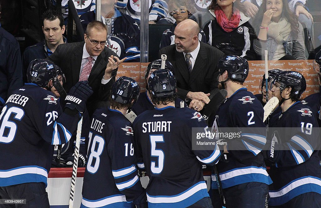 Head coach <a gi-track='captionPersonalityLinkClicked' href=/galleries/search?phrase=Paul+Maurice+-+Coach&family=editorial&specificpeople=13636283 ng-click='$event.stopPropagation()'>Paul Maurice</a> of the Winnipeg Jets speaks with his team during a break in third-period action in an NHL game against the Boston Bruins at the MTS Centre on April 10, 2014 in Winnipeg, Manitoba, Canada.