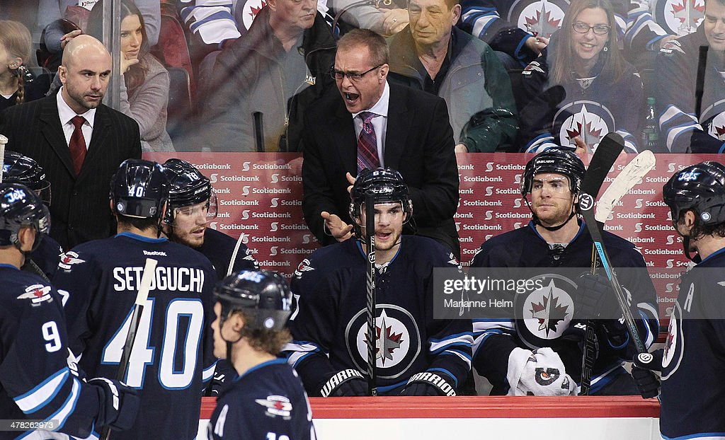 Head coach Paul Maurice of the Winnipeg Jets talks to his team from the bench during a break in third-period action in an NHL game against the Vancouver Canucksat the MTS Centre on March 12, 2014 in Winnipeg, Manitoba, Canada.