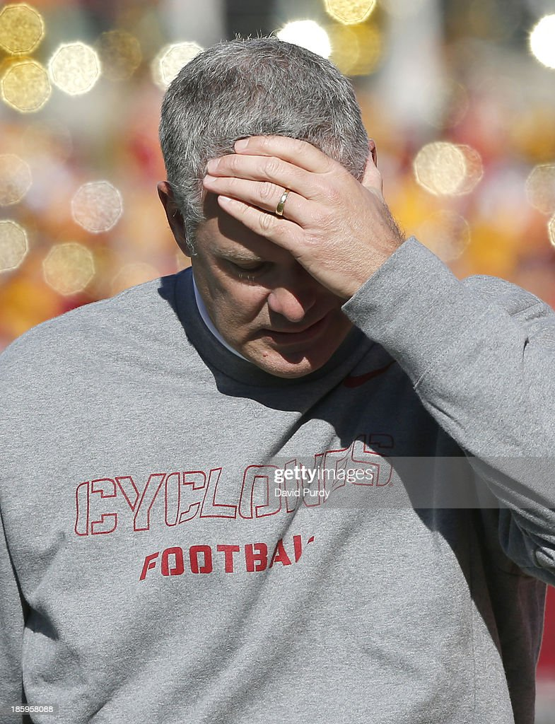 Head coach Paul Rhoads of the Iowa State Cyclones rubs his forehead after arguing a call by the referees in the first half of play against the Oklahoma State Cowboys at Jack Trice Stadium on October 26, 2013 in Ames, Iowa. The Oklahoma State Cowboys defeated the Iowa State Cyclones 58-27.